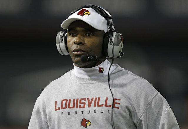 Louisville head coach Charlie Strong watches from the sidelines in the first half of an NCAA college football game against Cincinnati, Thursday, Dec. 5, 2013, in Cincinnati. (AP Photo/Al Behrman)