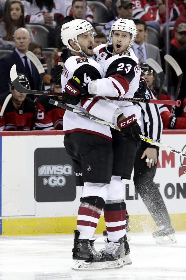 Arizona Coyotes defenseman Oliver Ekman-Larsson (23) celebrates his first period goal with defenseman Niklas Hjalmarsson (4), of Sweden, during an NHL hockey game against the New Jersey Devils, Saturday, March 23, 2019, in Newark, N.J. (AP Photo/Julio Cortez)