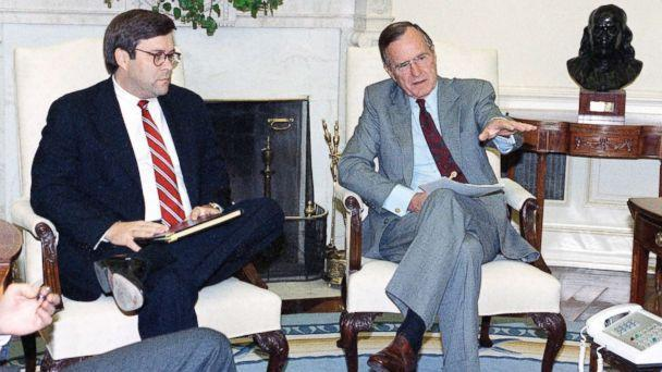 PHOTO: President George H. Bush gestures while talking to Attorney General William Barr in the Oval Office of the White House, May 4, 1992 in Washington. (Marcy Nighswander/AP, FILE)