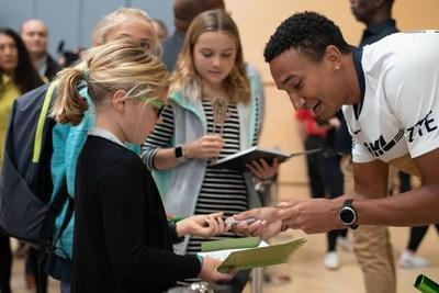 Donavan Brazier, 2019 World Champion in the 800m where he set a new American and Championship record, signs autographs for young track & field fans.