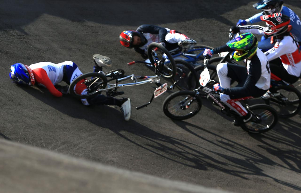 LONDON, ENGLAND - AUGUST 09: (EDITORS NOTE. Image is a retransmission with an alternative crop) Joris Daudet (L) of France goes to ground as the pack crash during the Men's BMX Cycling Quarter Finals on Day 13 of the London 2012 Olympic Games at BMX Track on August 9, 2012 in London, England.  (Photo by Phil Walter/Getty Images)