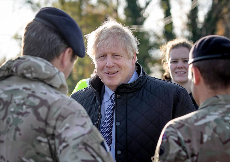 Prime Minister Boris Johnson chats soldiers during a visit to Stainforth, Doncaster, to see the recent flooding. (Photo: PA Wire/PA Images)