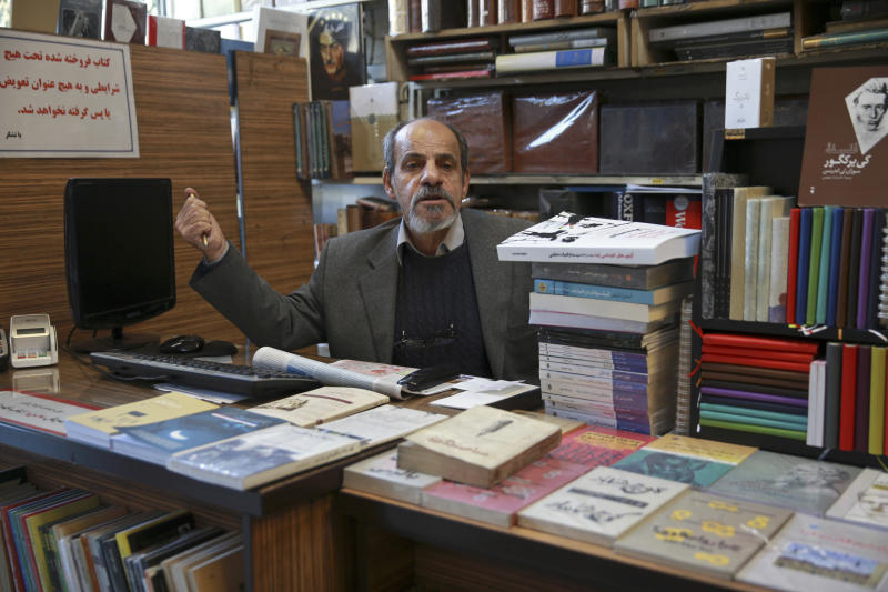 In this Jan. 23, 2019 photo, bookseller Mohsen Fat'hi, a former revolutionary, speaks with The Associated Press about Iran's 1979 Islamic Revolution at his shop, in downtown Tehran, Iran. During the uprising, Fat'hi made gasoline bombs, sold banned books and reprinted pamphlets with statements from Ayatollah Ruhollah Khomenini, the exiled cleric who eventually became the country's supreme leader. For all the risks Fat'hi took in supporting the revolution, he described himself today as disappointed. (AP Photo/Vahid Salemi)