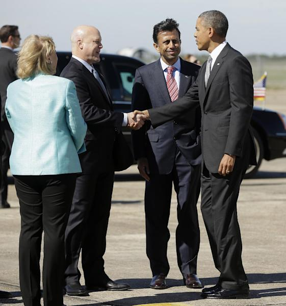 President Barack Obama is greeted by Gov. Bobby Jindal, center, and New Orleans Mayor Mayor Mitchell Landrieu, on the tarmac upon his arrival on Air Force One at Louis Armstrong International Airport, Friday, Nov. 8, 2013. Obama traveled to the Gulf Coast region to visit the Port of New Orleans to make a case that more exports equal more jobs. After New Orleans he will go to Miami area for three Democratic fundraisers. At left is Sen. Mary Landrieu, D-La. who traveled from Washington with the president. (AP Photo/Pablo Martinez Monsivais)