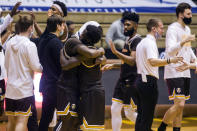 Valparaiso's Zion Morgan, center left, and Daniel Sackey hug after defeating Drake in an NCAA college basketball game on Sunday, Feb. 7, 2021, in Valparaiso, Ind. (AP Photo/Robert Franklin)