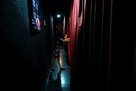 A theatre staff member stands in the hallway before a performance at Microteatro Por Dinero (Microtheatre for money) in central Madrid, Spain September 2, 2016. Picture taken September 2, 2016. REUTERS/Andrea Comas