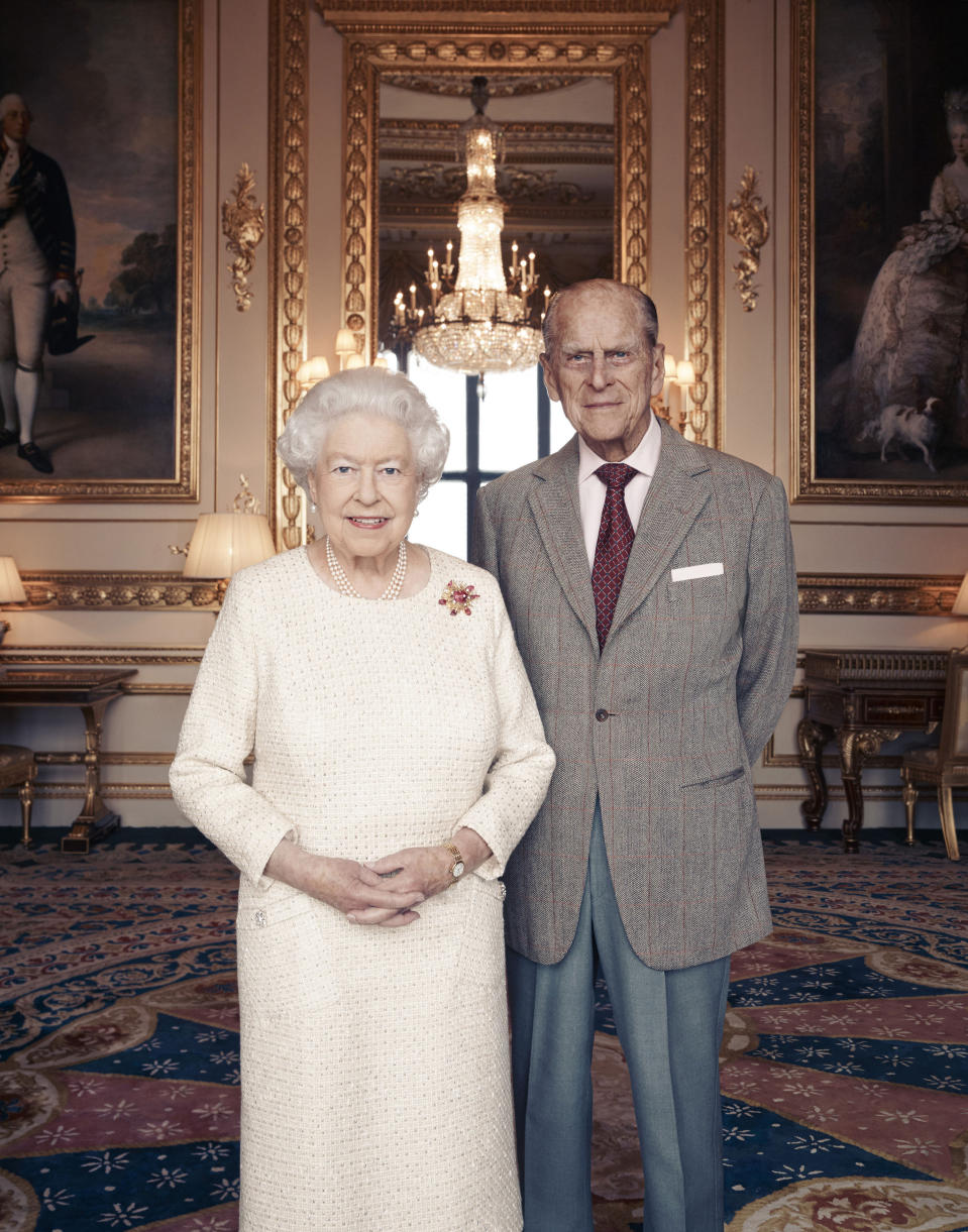 EDITORIAL USE ONLY MANDATORY CREDIT REQUIRED Handout file photo, first issued 18/11/17 by Camera Press of Queen Elizabeth II and the Duke of Edinburgh by British photographer Matt Holyoak, taken in the White Drawing Room at Windsor Castle in early November, in celebration of their platinum wedding anniversary on November 20.