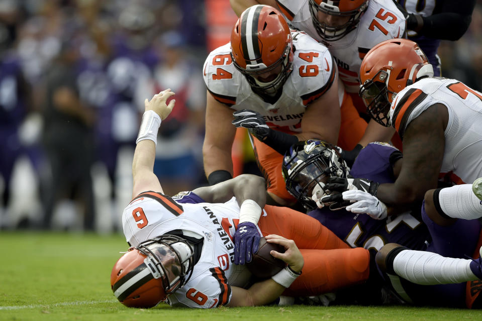 Cleveland Browns quarterback Baker Mayfield (6) is sacked by Baltimore Ravens linebacker Pernell McPhee during the first half of an NFL football game Sunday, Sept. 29, 2019, in Baltimore. (AP Photo/Gail Burton)