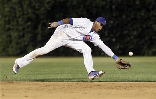 Chicago Cubs shortstop Starlin Castro can't make the play on a single hit by Boston Red Sox's Nick Punto during the ninth inning of an interleague baseball game in Chicago, Sunday, June 17, 2012. (AP Photo/Nam Y. Huh)