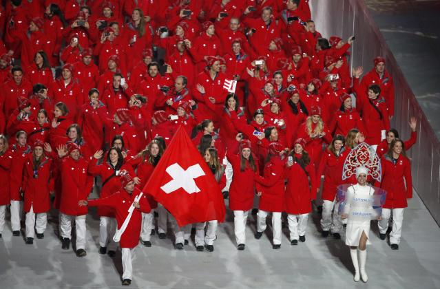 Switzerland's flag-bearer Simon Ammann leads his country's contingent during the athletes' parade at the opening ceremony of the 2014 Sochi Winter Olympics, February 7, 2014. REUTERS/Lucy Nicholson (RUSSIA - Tags: OLYMPICS SPORT)