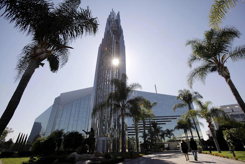 """FILE - This Oct. 27, 2011 photo shows the Crystal Cathedral in Garden Grove, Calif. Crystal Cathedral Ministries will keep airing the """"Hour of Power"""" television program and hold worship services in this famous glass-paned cathedral despite the departure of founding pastor Robert H. Schuller and his entire family, according to a statement issued Tuesday March 13, 2012. (AP Photo/Jae C. Hong, File)"""
