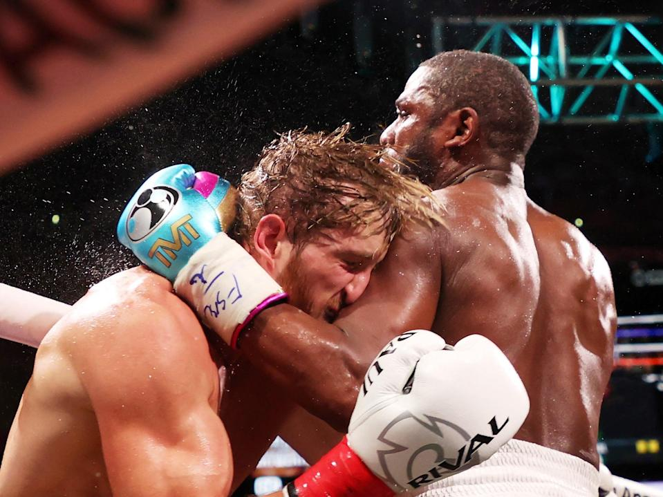 <p>Floyd Mayweather punches Logan Paul during their exhibition in Miami</p> (Getty)