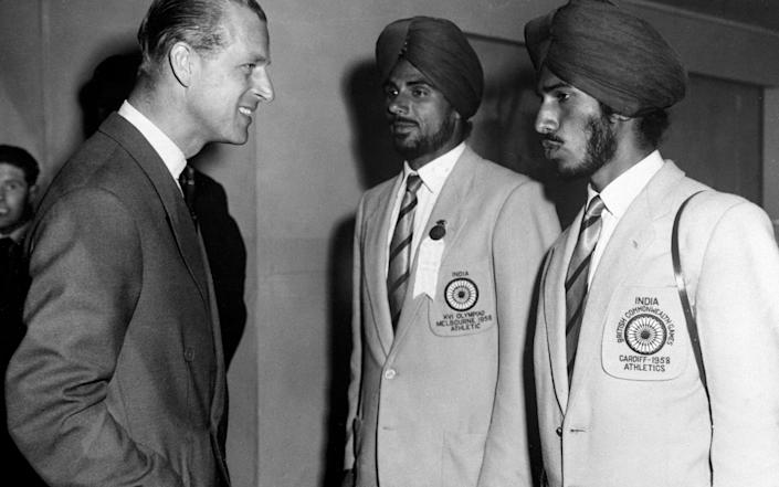 Milkha Singh, right, with his Indian teammate Mohinder Singh, meets the Duke of Edinburgh at the 1958 Empire and Commonwealth Games in Cardiff - S&G and Barratts