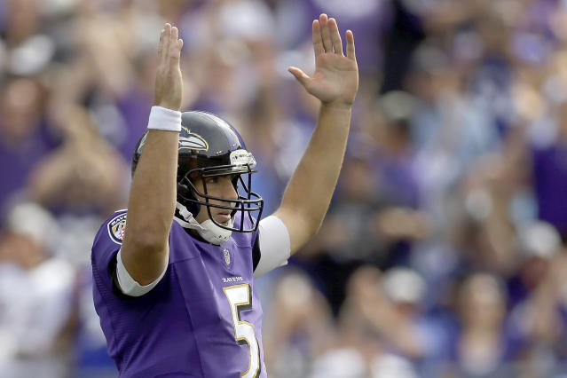 Baltimore Ravens quarterback Joe Flacco celebrates running back Bernard Pierce's touchdown during the second half of an NFL football game against the Cleveland Browns in Baltimore, Md., Sunday, Sept. 15, 2013. (AP Photo/Patrick Semansky)