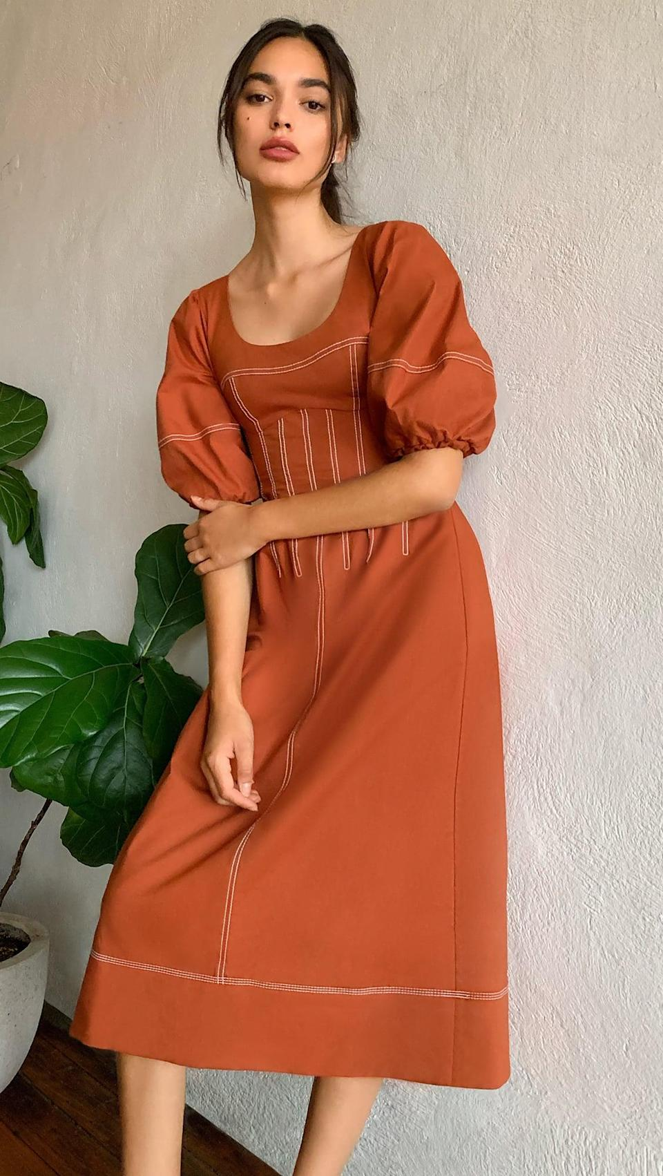 <p>Burnt orange is one of my favorite colors to wear year-round. It's eye-catching in a subtle yet powerful way. So I was super excited to discover this <span>Jonathan Simkhai Lena Puff Sleeve Midi Dress</span> ($495).</p>