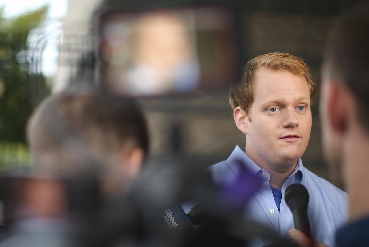 REFILE - CORRECTING TYPO IN ADAM WARD'S LAST NAMEChris Hurst (R), a journalist at the station and boyfriend of slain journalist Alison Parker, speaks with journalists outside of the offices for WDBJ7, where slain journalists Parker and Adam Ward worked in Roanoke, Virginia August 27, 2015. Parker, 24, and Ward, 27, were shot dead on Wednesday during a live segment for the CBS affiliate in Roanoke, Virginia, at a local recreation site about 200 miles (320 km) southwest of Washington. Another woman was wounded. The suspected gunman, 41-year-old Vester Flanagan, later died from a self-inflicted gunshot wound, authorities said. REUTERS/Chris Keane