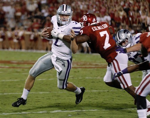 Kansas State quarterback Collin Klein (7) is stopped by Oklahoma linebacker Corey Nelson (7) during the second quarter of an NCAA college football game in Norman, Okla., Saturday, Sept. 22, 2012. (AP Photo/Sue Ogrocki)