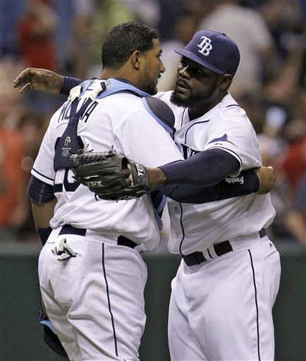 Tampa Bay Rays relief pitcher Fernando Rodney, right, hugs catcher Jose Molina after closing out the Los Angeles Angels during the ninth inning of a baseball game, Wednesday, April 25, 2012, in St. Petersburg, Fla. The Rays won the game 3-2. (AP Photo/Chris O'Meara)