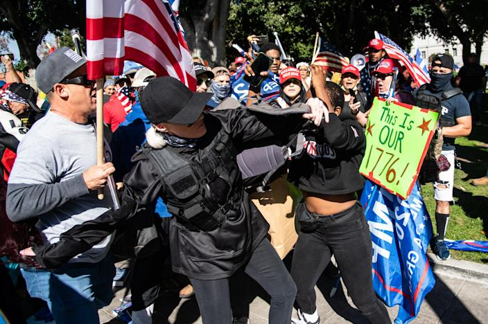 Berlinda is surrounded by a hostile crowd of Trump supporters on Jan. 6, 2021, in Los Angeles. (Raquel Natalicchio)