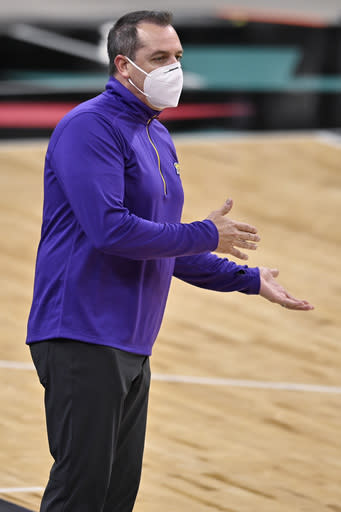 Los Angeles Lakers coach Frank Vogel shouts to his players during the first half of an NBA basketball game against the San Antonio Spurs, Friday, Jan. 1, 2021, in San Antonio. (AP Photo/Darren Abate)