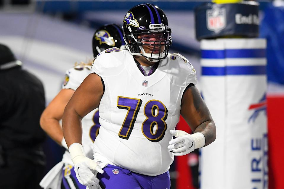 Baltimore Ravens offensive tackle Orlando Brown (78) jogs on the field prior to an AFC Divisional Round game against the Buffalo Bills at Bills Stadium.