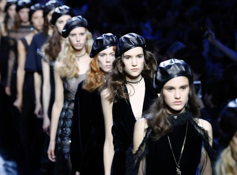 Dior models in Black Panther leather berets