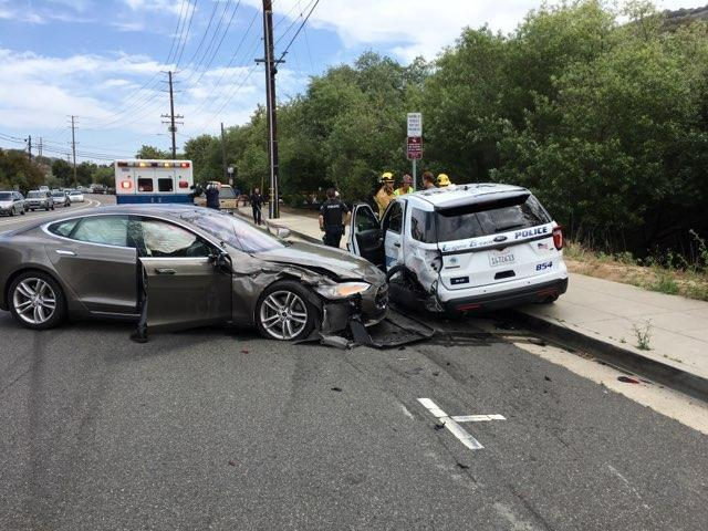 A Tesla sedan is shown after it struck a parked Laguna Beach Police Department vehicle in Laguna Beach, California, U.S. in this May 29, 2018 handout photo.  Laguna Beach Police Department/Handout via REUTERS  ATTENTION EDITORS - THIS IMAGE WAS PROVIDED BY A THIRD PARTY.  BEST QUALITY AVAILABLE.