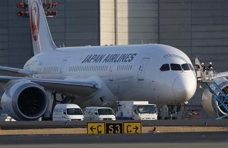 Staff of JAL enter the company's Boeing Co's 787 Dreamliner plane at New Tokyo international airport in Narita