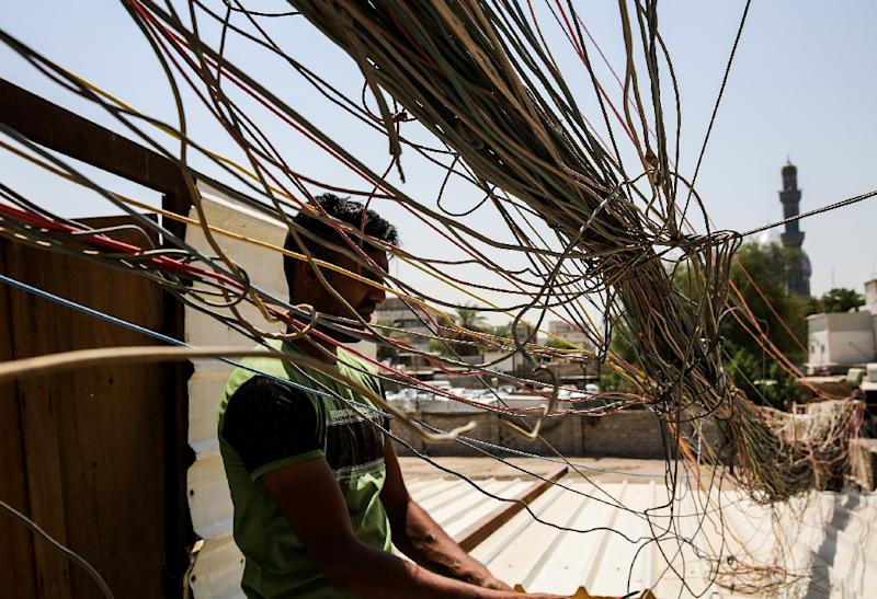 Iraq is looking to revamp power stations and lines to cut waste, as well as import power and improve bill collection to boost revenues (AFP Photo/SABAH ARAR)
