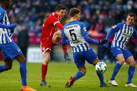 Soccer Football - Bundesliga - Bayern Munich vs Hertha BSC - Allianz Arena, Munich, Germany - February 24, 2018 Bayern Munich's Robert Lewandowski shoots at goal REUTERS/Michaela Rehle