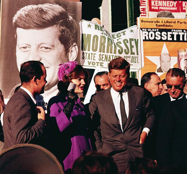 """FILE - In this October 1960 file photo Sen. John F. Kennedy and his wife, Jacqueline Kennedy, campaign in New York. The Kennedy image, the """"mystique"""" that attracts tourists and historians alike, did not begin with his presidency and is in no danger of ending 50 years after his death. Its journey has been uneven, but resilient - a young and still-evolving politician whose name was sanctified by his assassination, upended by discoveries of womanizing, hidden health problems and political intrigue, and forgiven in numerous polls that place JFK among the most beloved of former presidents. (AP Photo)"""