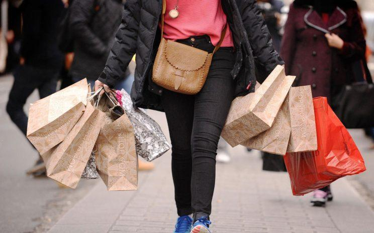 Woman shopping in the High Street/PA Photos