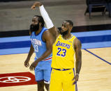 Los Angeles Lakers forward LeBron James (23) watches his shot next to Houston Rockets guard James Harden (13) during an NBA basketball game Tuesday, Jan. 12, 2021, in Houston. (Mark Mulligan/Houston Chronicle via AP)