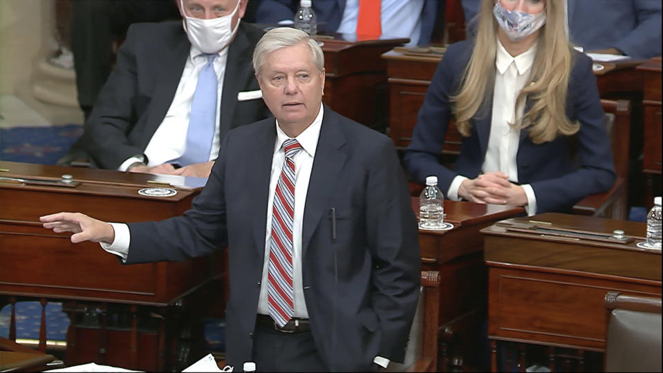 In this image from video, Sen. Lindsey Graham, R-S.C., speaks as the Senate reconvenes to debate the objection to confirm the Electoral College Vote from Arizona, after protesters stormed into the U.S. Capitol on Wednesday, Jan. 6, 2021. (Senate Television via AP)