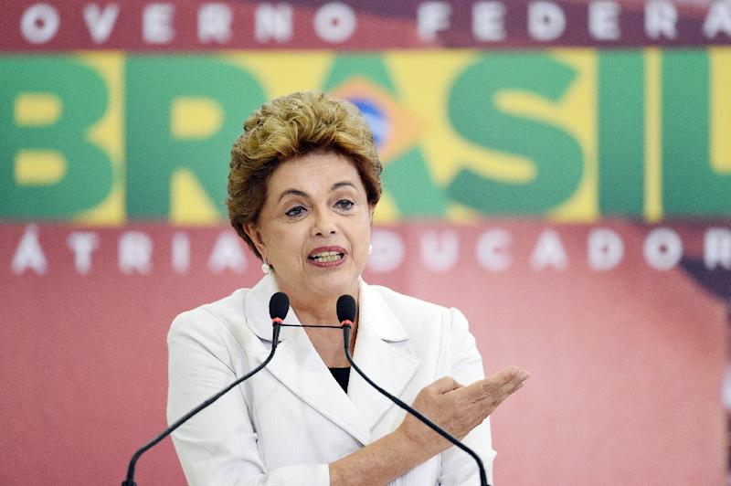 Brazilian President Dilma Rousseff delivers a speech at Planalto Palace in Brasilia on March 30, 2016 (AFP Photo/Evaristo Sa)
