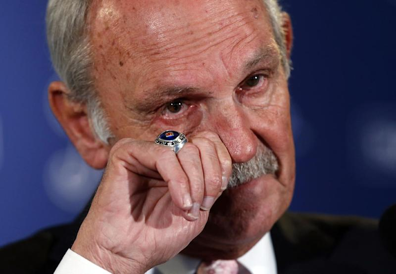 FILE - In this Oct. 21, 2013, file photo, Detroit Tigers baseball manager Jim Leyland wipes his face as he announces that he is stepping down as manager of the baseball club during a news conference at Comerica Park in Detroit. (AP Photo/Paul Sancya, File)