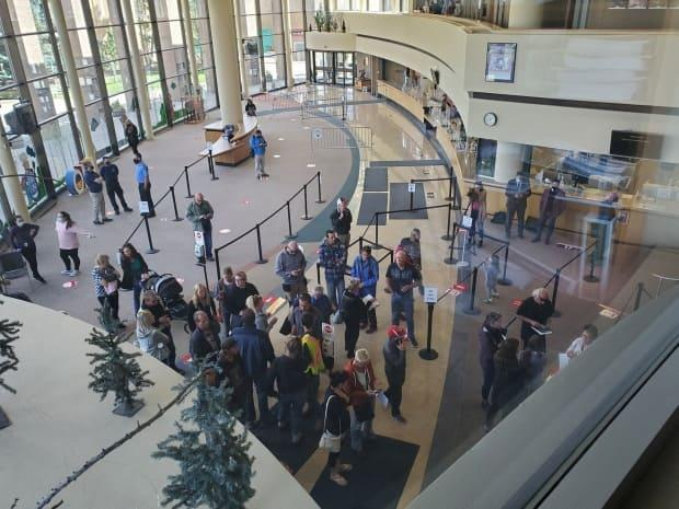 Between 60-80 people made their way into Lethbridge city council chambers, pictured, to protest the city's masking bylaw in September. (Rob Miyashiro/Twitter - image credit)
