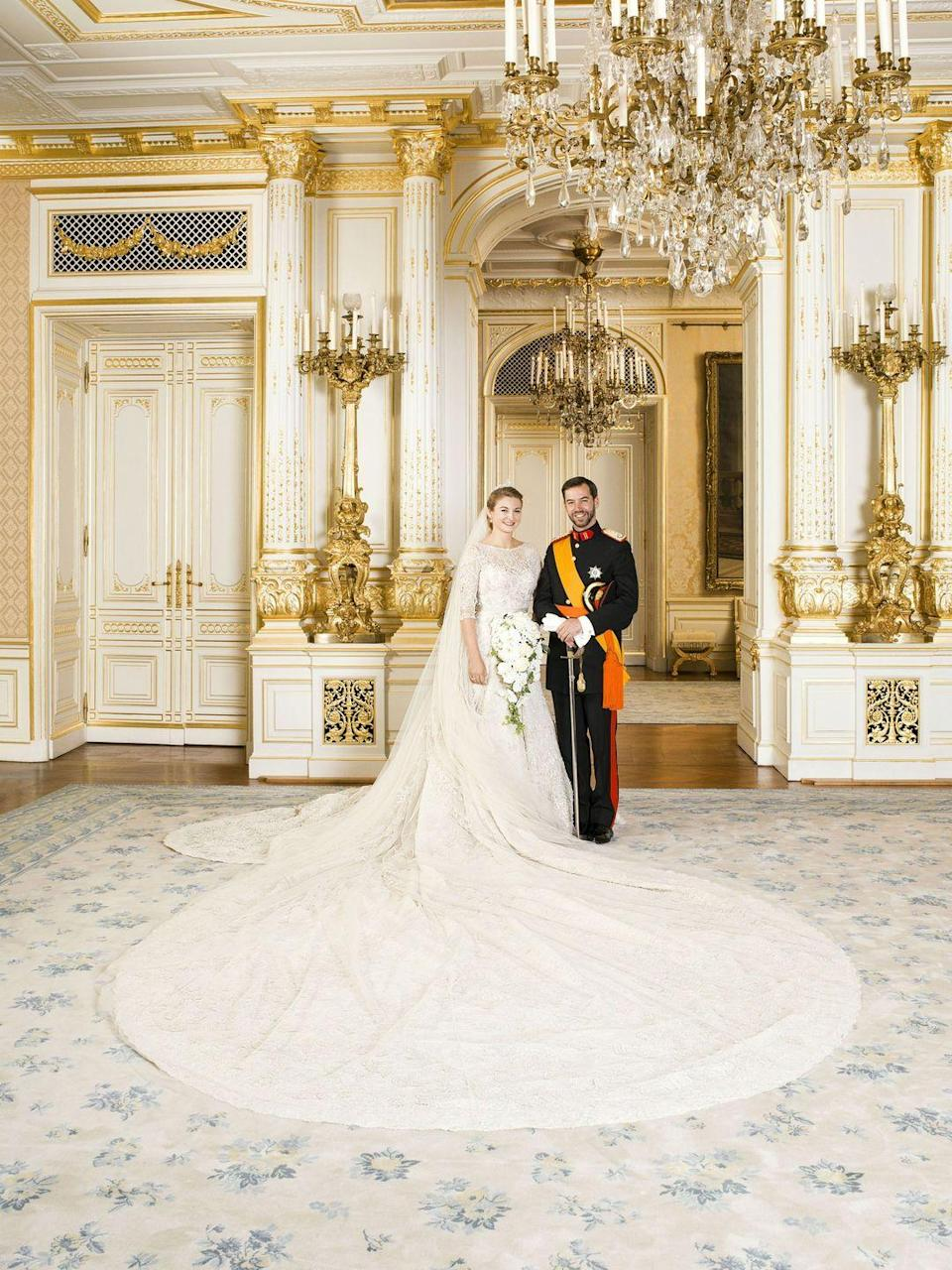 <p>For her 500,000 euro wedding to the heir of Luxembourg's throne, the Belgian duchess wore an ivory Elie Saab gown with structured tailoring and elaborate detailing. The dress featured three-quarter length sleeves, a silk tulle veil, and a 13-foot long train.</p>