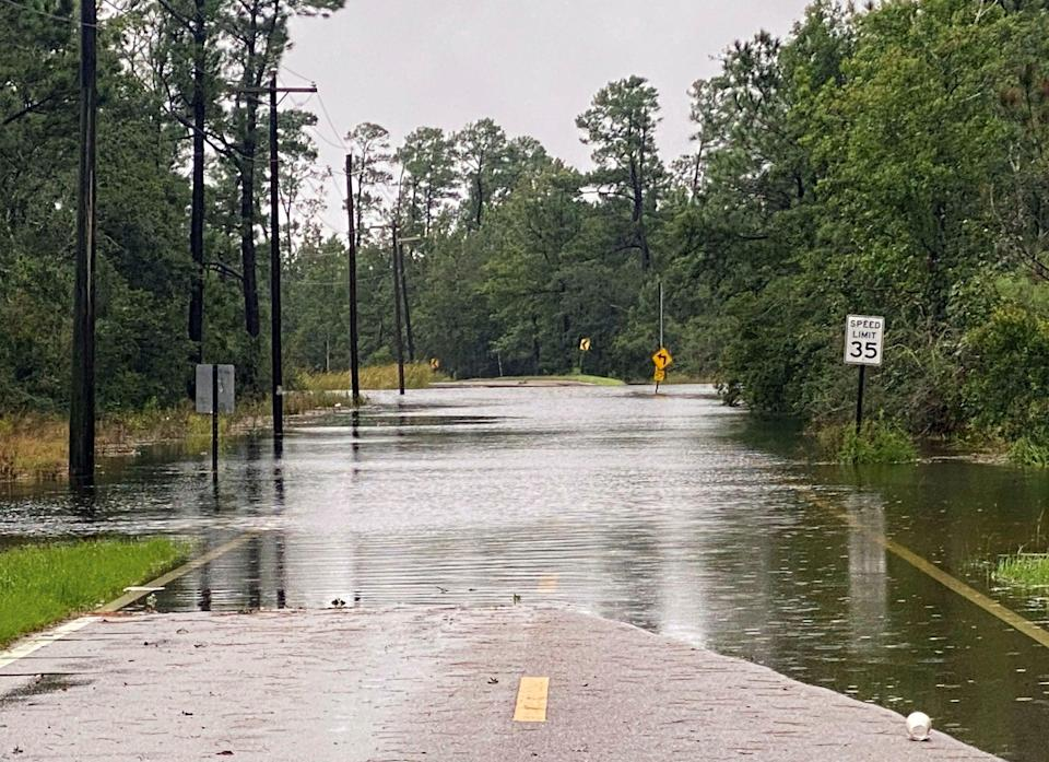 Henderson Avenue in Pass Christian, Miss. completely flooded as a result of the arrival of Hurricane Ida early Sunday, Aug. 29, 2021. (Hunter Dawkins/The Gazebo Gazette via AP) (AP)