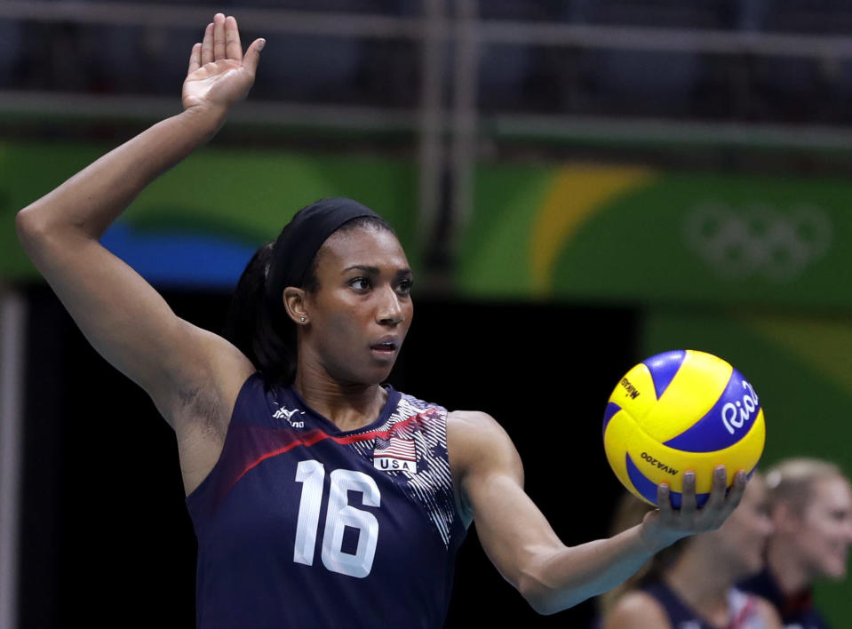 FILE - In this Aug. 16, 2016, file photo, United States' Foluke Akinradewo prepares to serve during a women's quarterfinal volleyball match against Japan at the Summer Olympics in Rio de Janeiro. Middle Foluke Akinradewo Gunderson is back for a third Olympics after a busy stretch since the games in Rio. Those games had a sour ending for Gunderson, whose knee injury in the first set of the semifinal sidelined her for the rest of the match and contributed to the team's loss to Serbia. Gunderson got married since then and gave birth to her first child in November 2019 but has used the extra year off to get back into form for these games. (AP Photo/Jeff Roberson, File)