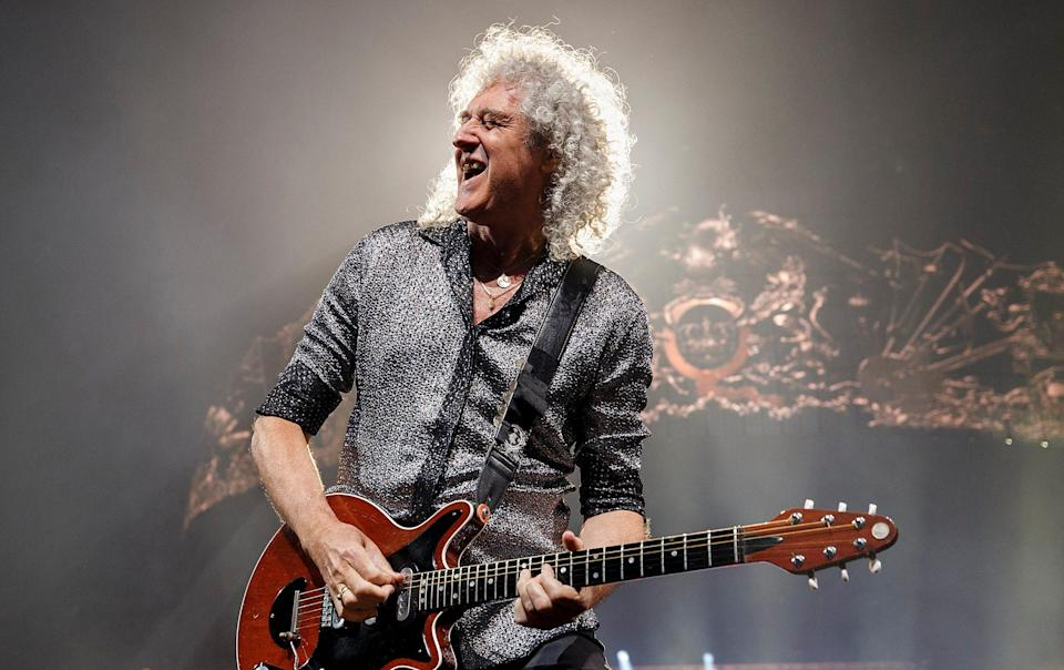 May and Queen will return to the stage for a rescheduled tour next year - Andrew Chin