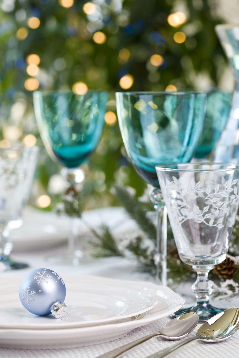 """<p>Transform your NYE party into an enchanting winter wonderland full of gorgeous <a href=""""https://www.amazon.com/Christmas-Snowflake-Hanging-Snowflakes-Decorations/dp/B07VRPKL9X/ref=sr_1_9?keywords=snowflake+decorations&qid=1575396790&sr=8-9&tag=syn-yahoo-20&ascsubtag=%5Bartid%7C10055.g.30105731%5Bsrc%7Cyahoo-us"""" rel=""""nofollow noopener"""" target=""""_blank"""" data-ylk=""""slk:snowflake decorations"""" class=""""link rapid-noclick-resp"""">snowflake decorations</a>, <a href=""""https://www.amazon.com/CraftMore-Smokey-Pine-Garland-Christmas/dp/B01LQQQENS/ref=sr_1_3?keywords=winter+wonderland+decor&qid=1575397040&sr=8-3&tag=syn-yahoo-20&ascsubtag=%5Bartid%7C10055.g.30105731%5Bsrc%7Cyahoo-us"""" rel=""""nofollow noopener"""" target=""""_blank"""" data-ylk=""""slk:pine garlands"""" class=""""link rapid-noclick-resp"""">pine garlands</a> and a <a href=""""https://www.amazon.com/B-COOL-Square-Tablecloth-Thanksgiving-Sparkle/dp/B01LYBWV2T/ref=sr_1_4?keywords=winter+wonderland+decor&qid=1575397014&sr=8-4&tag=syn-yahoo-20&ascsubtag=%5Bartid%7C10055.g.30105731%5Bsrc%7Cyahoo-us"""" rel=""""nofollow noopener"""" target=""""_blank"""" data-ylk=""""slk:silver sequin tablecloth"""" class=""""link rapid-noclick-resp"""">silver sequin tablecloth</a> — and don't forget the cozy hot chocolate bar (mini marshmallows are a must, of course).</p>"""