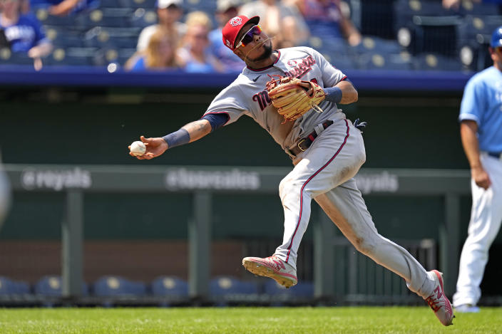 Minnesota Twins third baseman Luis Arraez throws to first after fielding a single by Kansas City Royals' Hunter Dozier during the seventh inning of a baseball game Sunday, July 4, 2021, in Kansas City, Mo. (AP Photo/Charlie Riedel)