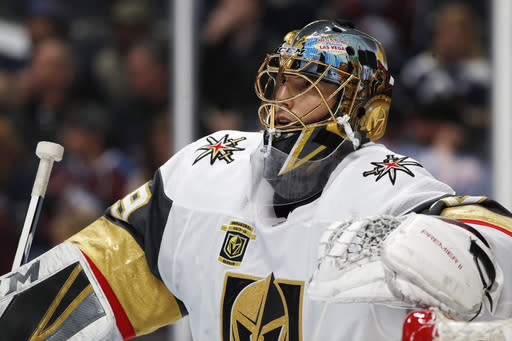 FILE - In this March 24, 2018, file photo, Vegas Golden Knights goaltender Marc-Andre Fleury leans on the top of the net during a timeout against the Colorado Avalanche in the third period of an NHL hockey game in Denver. (AP Photo/David Zalubowski, File)