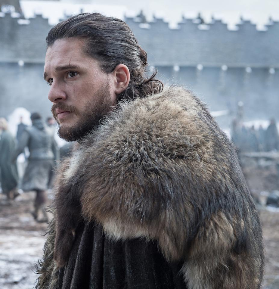 <p>A bundled-up Jon strikes a grim pose in what appears to be his former home of Winterfell. We're thinking that his reunion with Sansa and Arya wasn't as happy as he hoped. </p>