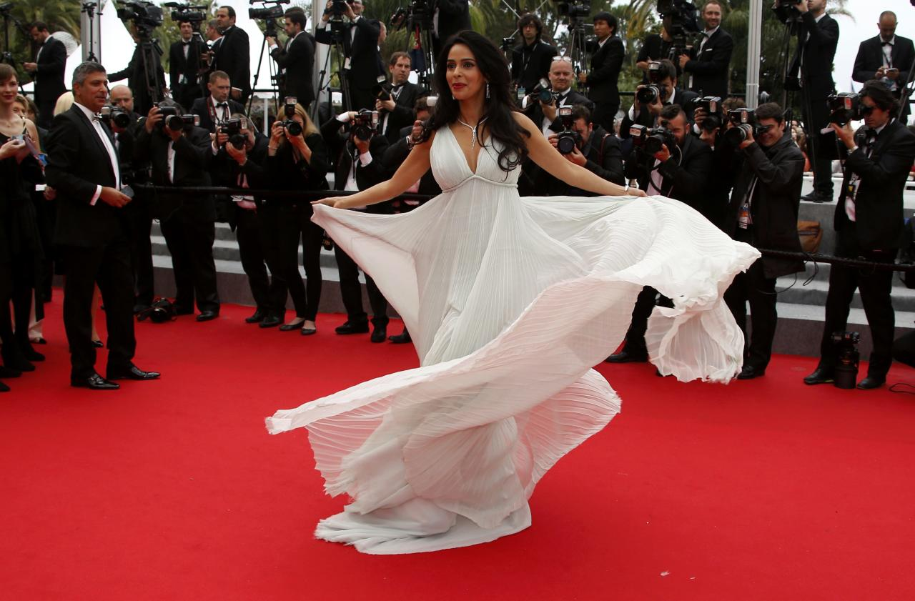 """Bollywood actress Mallika Sherawat poses on the red carpet as she arrives for the screening of the film """"Jimmy's Hall"""" in competition at the 67th Cannes Film Festival in Cannes"""
