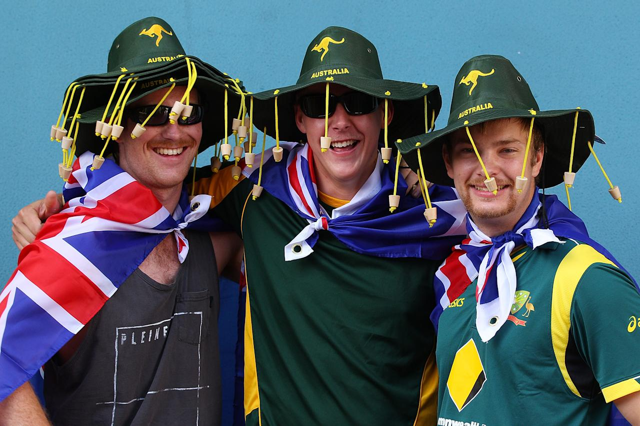 BRISBANE, AUSTRALIA - NOVEMBER 09:  Australian supporters arrive for day one of the First Test match between Australia and South Africa at The Gabba on November 9, 2012 in Brisbane, Australia.  (Photo by Chris Hyde/Getty Images)