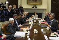 FILE - In this Oct. 6, 2014, file photo President Barack Obama sits across the table from Federal Reserve Chair Janet Yellen, left, and Treasury Secretary Jacob Lew during a meeting with financial regulators in the Roosevelt Room of the White House in Washington. (AP Photo/Evan Vucci, File)