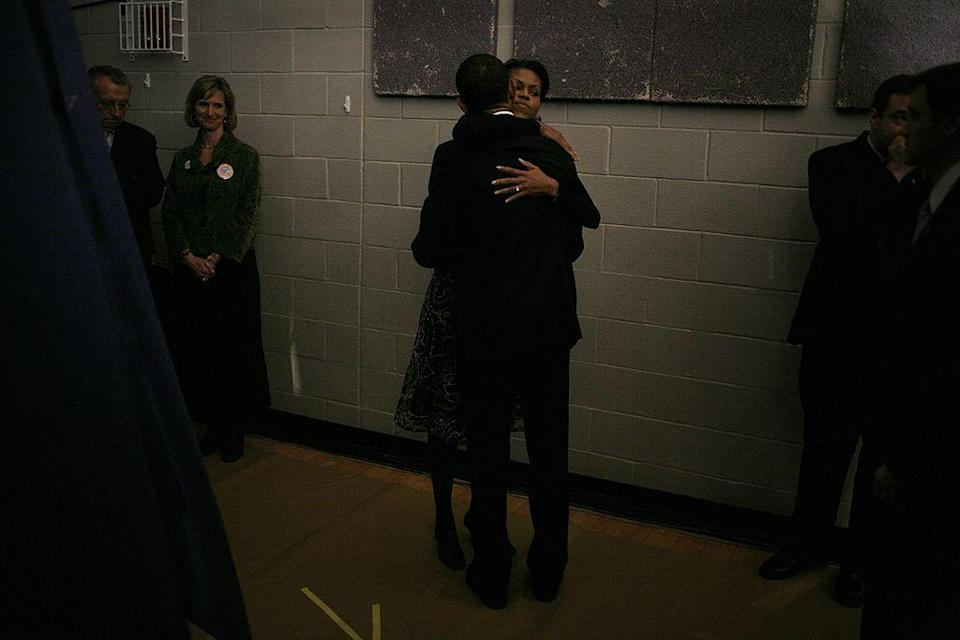 <p>Michelle and Barack backstage before a primary night rally in the gymnasium at the Nashua South High School [Photo: Charles Ommanney/Getty] </p>