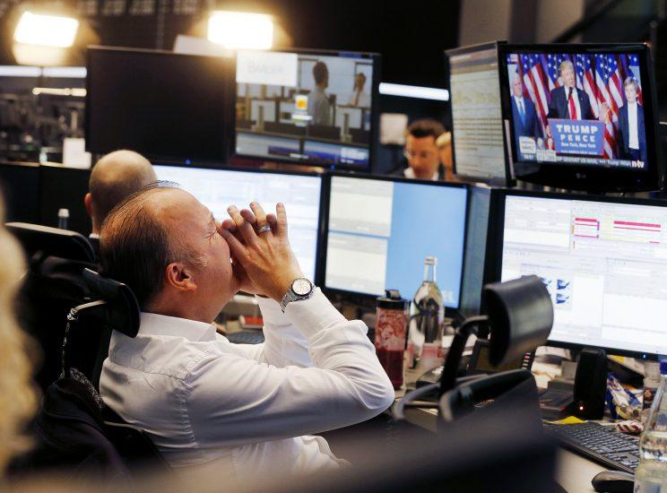 A broker reacts as U.S. President-elect Donald Trump shows up on a television screen at the stock market in Frankfurt, Germany, Nov. 9, 2016. (Photo: Michael Probst/AP)